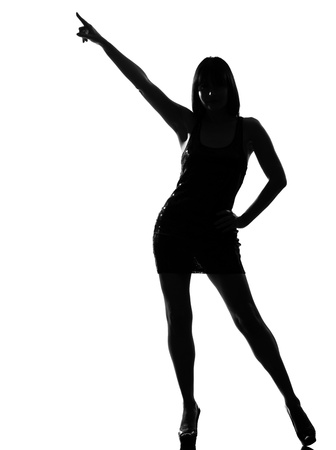 stylish silhouette caucasian beautiful woman dancing posture pointing full length on studio isolated white background Stock Photo - 9799838