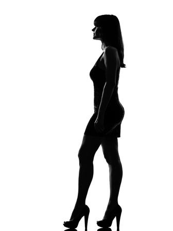 stylish silhouette caucasian beautiful woman standing profile full length on studio isolated white background Stock Photo - 9799834