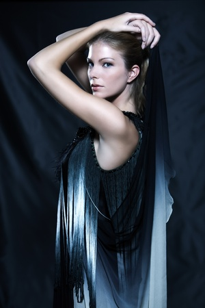 fashion pictures of a beautiful woman wearing silk fringe black and white dress chinese style doing martial arts postur Stock Photo - 9823603