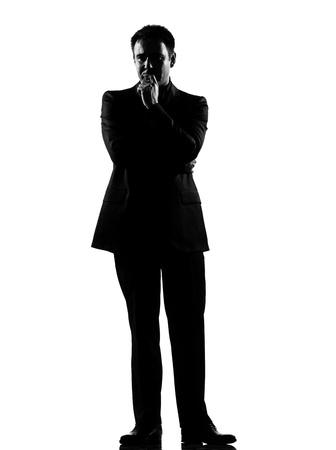 black business man: silhouette business caucasien homme pens�e pensive exprimant son comportement pleine longueur sur studio isol� fond blanc