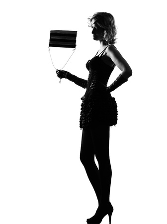 prostitute: stylish silhouette caucasian beautiful with purse woman sexy  attitude behavior clothes full length on studio isolated white background