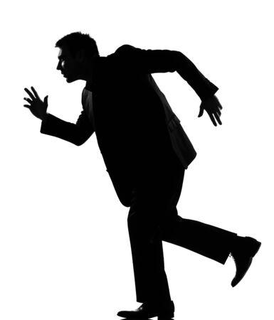 silhouette caucasian business man  expressing behavior full length on studio isolated white background Stock Photo - 9799914