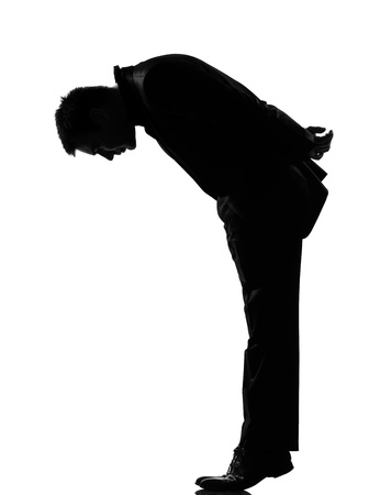 bending down: silhouette caucasian business man   man  tip toe looking down expressing behavior full length on studio isolated white background