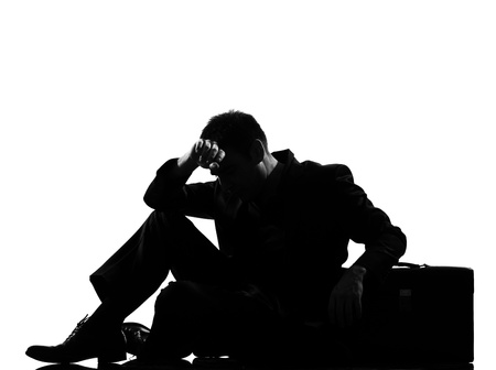 weary: silhouette caucasian business man  expressing fatigue despair tired behavior briefcase  full length on studio isolated white background