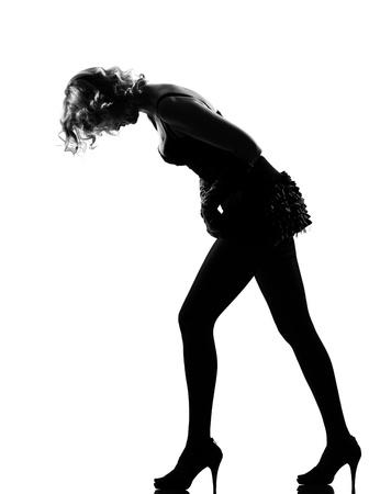 stylish silhouette caucasian beautiful woman sexy  attitude adusting mini skirt behavior clothes full length on studio isolated white background Stock Photo - 9799955