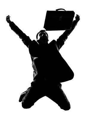 overcome: silhouette caucasian business man  expressing winning winner energy success  full length on studio isolated white background