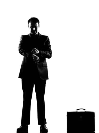 isolated on the white background: silhouette caucasian business man  waiting checking the time full length on studio isolated white background