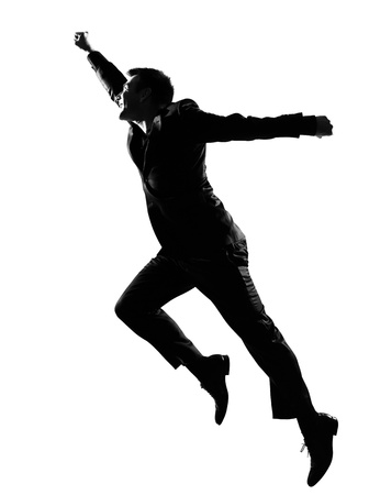 stepping: silhouette caucasian business man  expressing winning behavior full length on studio isolated white background