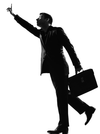 hailing: silhouette caucasian business man  running hailing full length on studio isolated white background