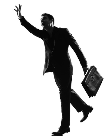 the stepping: silhouette caucasian business man  running hailing full length on studio isolated white background