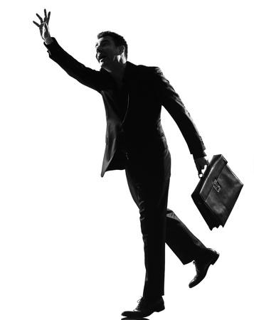 silhouette caucasian business man  running hailing full length on studio isolated white background Stock Photo - 9800052