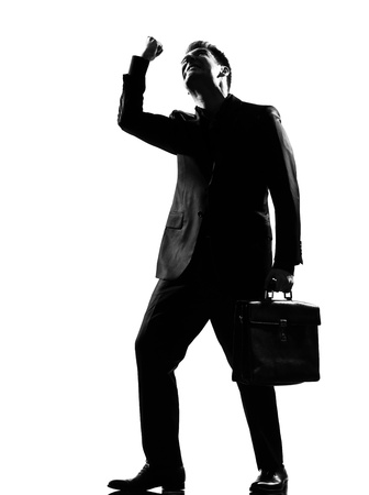 impatient: silhouette caucasian business man  expressing anger adversity despair looking up behavior full length on studio isolated white background