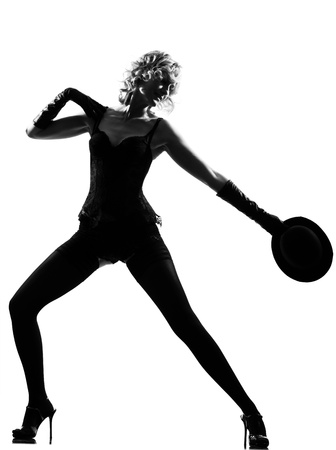 stylish silhouette caucasian beautiful woman dancing cabaret sexy  attitude behavior clothes full length on studio isolated white background Stock Photo - 9800028