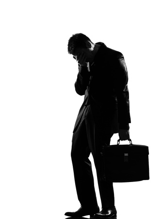 desperately: silhouette caucasian business man  expressing fatigue despair tired behavior full length on studio isolated white background LANG_EVOIMAGES