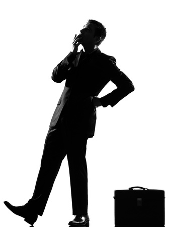 waiting posture: silhouette caucasian business man thinking pensive behavior  looiking up full length on studio isolated white background