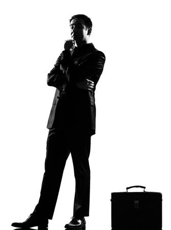 waiting posture: silhouette caucasian business man thinking pensive behavior full length on studio isolated white background