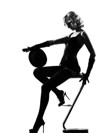 stylish silhouette caucasian beautiful woman dancing cabaret sexy  attitude behavior clothes full length on studio isolated white background Stock Photo - 9800044