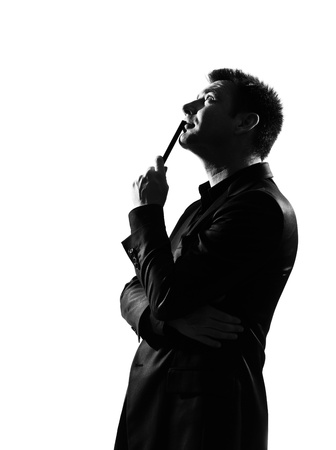 silhouette caucasian business man thinking pensive behavior full length on studio isolated white background Stock Photo - 9800089