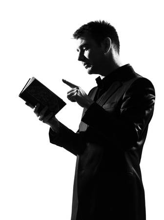 silhouette caucasian business man with note pad  expressing behavior full length on studio isolated white background Stock Photo - 9800114