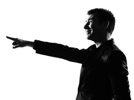 mocking: silhouette caucasian business man  expressing pointing mocking sneering behavior full length on studio isolated white background