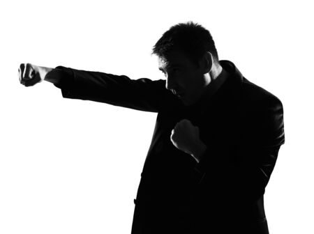 silhouette caucasian business man boxing gesture  expressing behavior full length on studio isolated white background Stock Photo - 9799997