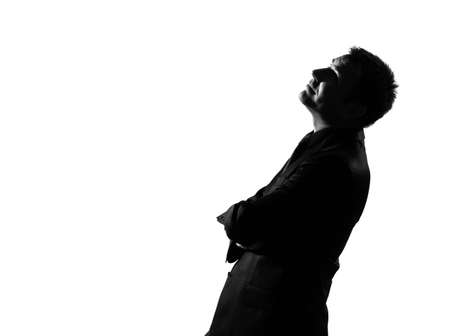 daydream: silhouette caucasian business man  musing daydream looking up behavior full length on studio isolated white background