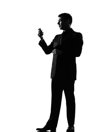 sms text: silhouette caucasian business man on the phone  sms text messaging full length on studio isolated white background