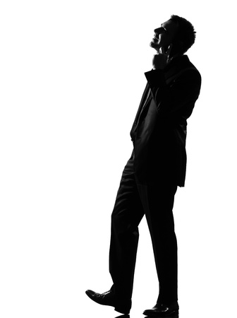 silhouette caucasian business man on the phone expressing behavior full length on studio isolated white background Stock Photo - 9799844