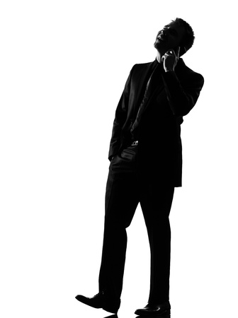 silhouette caucasian business man on the phone expressing behavior full length on studio isolated white background Stock Photo - 9799842