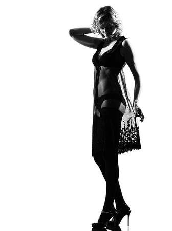 stylish silhouette caucasian beautiful woman sexy  attitude behavior clothes full length on studio isolated white background photo