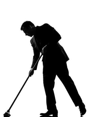 silhouette caucasian business man  wiping brooming  behavior full length on studio isolated white background Stock Photo - 9799921