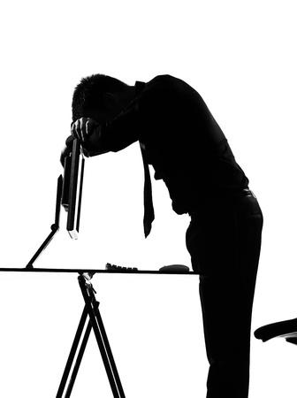silhouette caucasian business man  computing expressing tired sad behavior full length on studio isolated white background Stock Photo - 9799985