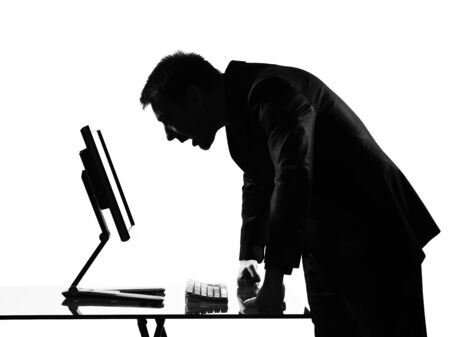 annoyed: silhouette caucasian business man  computing expressing behavior full length on studio isolated white background
