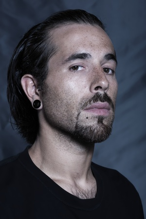 urban stylish caucasian young man with pierced ears and piercing studio portrai Stock Photo - 9823714