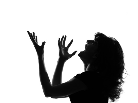 portrait silhouette in shadow of a young woman screaming anger  in studio on white background isolated Stock Photo - 9800035