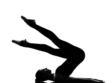 leotard: beautiful caucasian tall woman ballet dancer halasana Shoulder Stand yoga pose full length on studio isolated white background LANG_EVOIMAGES