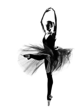 en pointe: beautiful caucasian tall woman ballet dancer full length on studio isolated white background
