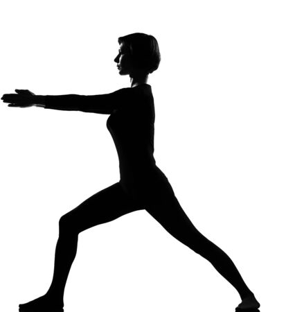 stretch out: woman virabhadrasana 2 warrior exercising fitness yoga stretching in shadow grayscale silhouette full length in studio isolated white background