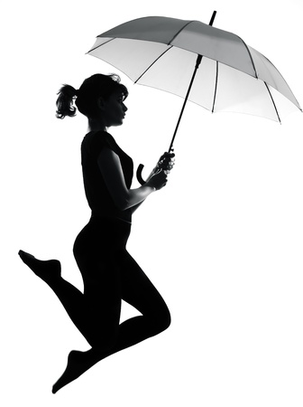 black kite: full length silhouette in shadow of a young woman flying with open umbrella  in studio on white background isolated