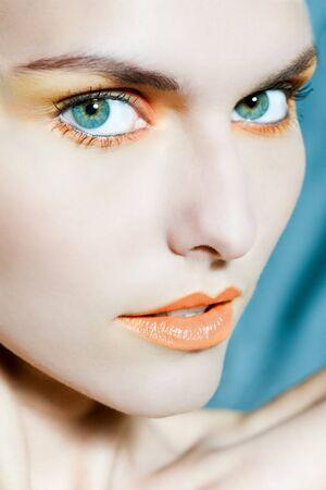 beauty portrait close up of a beautiful woman with orange make u Stock Photo - 9800083