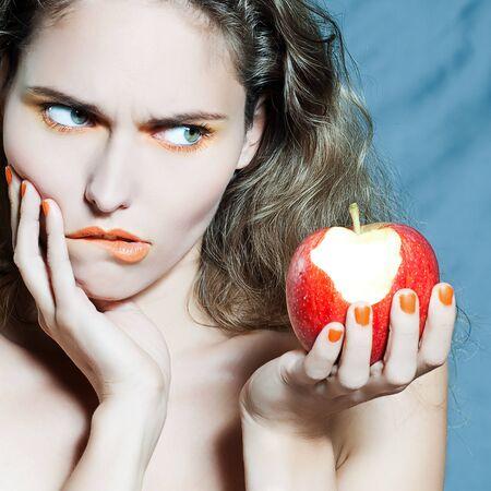 studio portrait of a beautiful woman holding apple frui Stock Photo - 9823697
