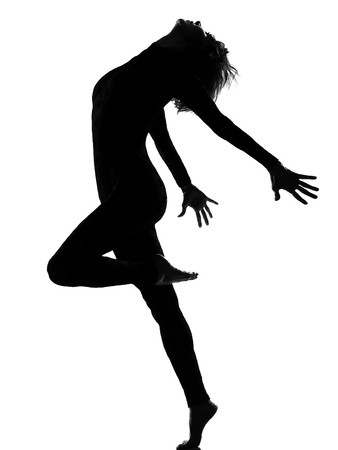 woman in shadow silhouette full length in studio isolated white background Stock Photo - 9799846