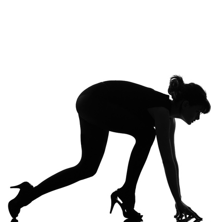 full length silhouette in shadow of a young woman knel sprint run  in studio on white background isolated Stock Photo - 9799867