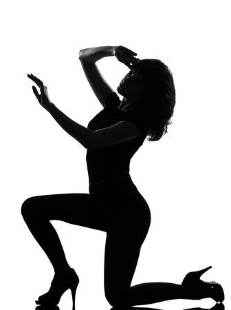 full length silhouette in shadow of a young woman kneel   in studio on white background isolated Stock Photo - 9799957