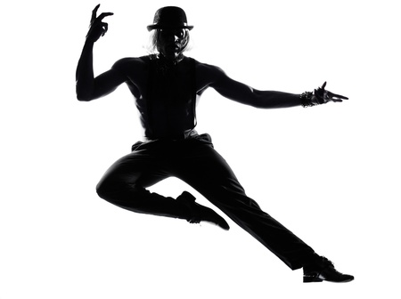 one  african man dancer dancing cabaret burlesque on studio isolated white background photo