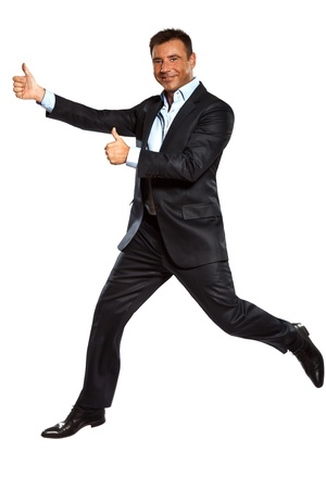 jump suit: one caucasian business man running jumping double thumbs up in studio isolated on white background