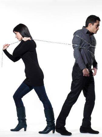 woman binding his man with a chain on white background Stock Photo - 11766515