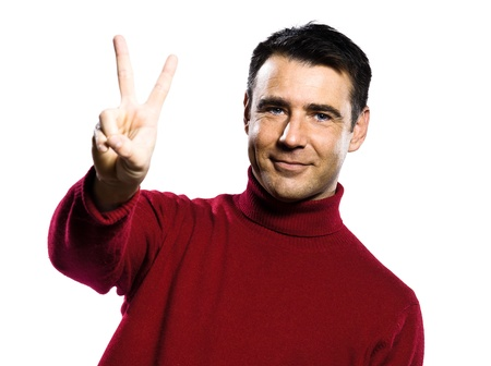 caucasian man 2 two  counting showing  fingers  gesture studio portrait on isolated white backgound photo