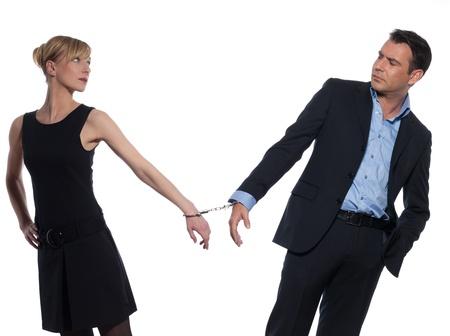 woman handcuffs: beautiful caucasian couple on studio white background with handcuffs