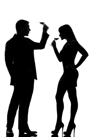 one caucasian couple man and woman drinking red wine tasting  in studio silhouette isolated on white background Stock Photo - 11610350